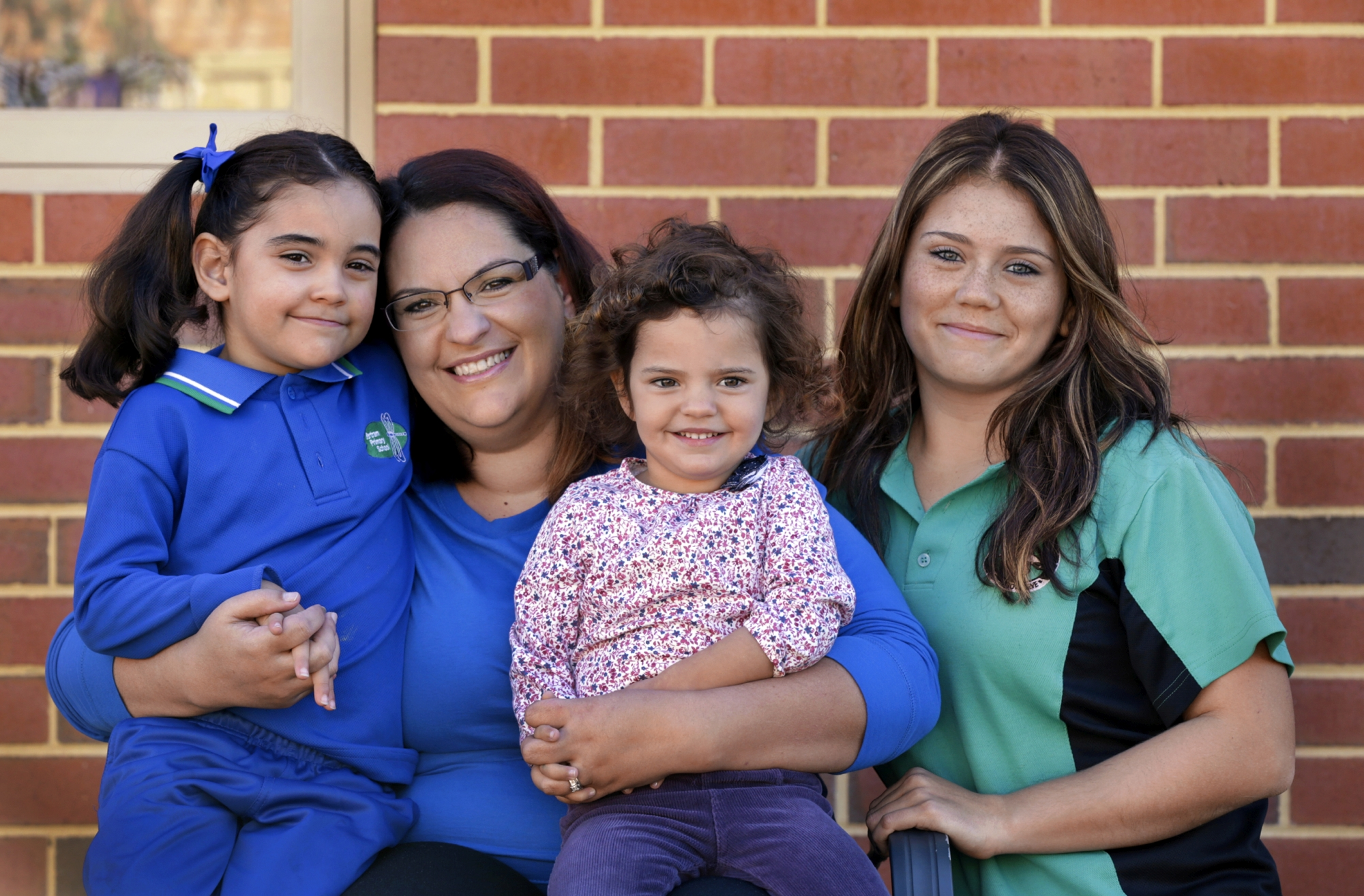 Lita Santos (centre), who has multiple sclerosis, with her daughters Amalia (5), Olivia (2) and Marta (16). Picture: Elle Borgward www.communitypix.com.au d423370