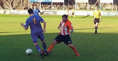 Cockburn's Jesse Fuller looks to evade a tackle from Sorrento's James Morgan. Picture: Football West News