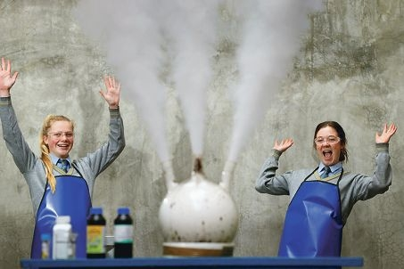 Emily Benson and Shaydn Gill having fun with the 'Witches Cauldron' experiment.
