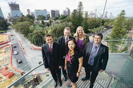 IBM team members Ian Watson-Jones, Jeffrey Wells, Lijun Sun, Deb Bolk and Luciano Dallolio.