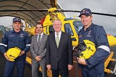 Rescue helicopter aircrew Cam Coulson and Scott Hardstaff flank SLSWA president Mark Irwin and Premier Colin Barnett.