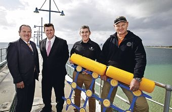 Safer for sharks, safer for swimmers: Rockingham mayor Barry Sammels, MLC Phil Edman, Sea Shepherd MD Jeff Hansen and Eco Shark Barrier owner Craig Moss say the Coogee Beach trial was a success.d423090