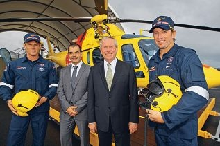 Aircrew Cam Coulson and Scott Hardstaff flank SLSWA president Mark Irwin and Premier Colin Barnett. Picture: Bruce Hunt