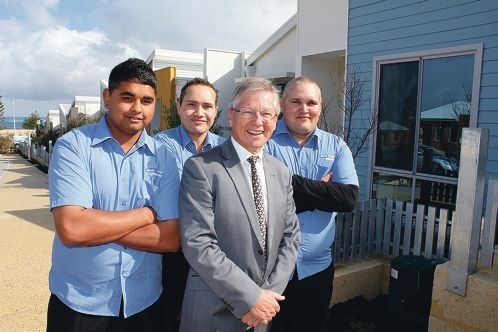 Housing Minister Bill Marmion (front) with Chris Edmonds and Matthew and Hermann Haltiner.