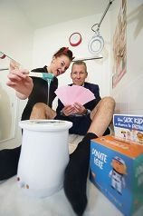 Smooth move: Beauty therapist Linzi Cross with BoQ manager Matthew Hall, who is getting his legs waxed to raise money for children's hospitals.Picture: Emma Goodwin d423311