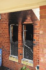 The rear of the fire-damaged property. d423206