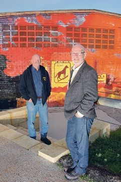North Fremantle councillors Robert Fittock and Doug Thompson in front of the 40-year-old mural. Picture: Jon Bassett
