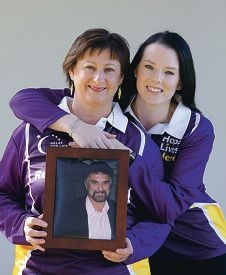 Karen Bailey, of Waterford, with a photograph of her brother Kevin Fuller, and her daughter Kerry Bailey. Picture: Martin Kennealey www.communitypix.com.au d423100
