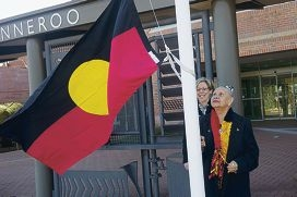 Aboriginal Elder and City of Wanneroo Reconciliation Action Plan Working Group member Oriel Green raises the Aboriginal flag. Pictures: Emma Reeves www.communitypix.com.au d422695