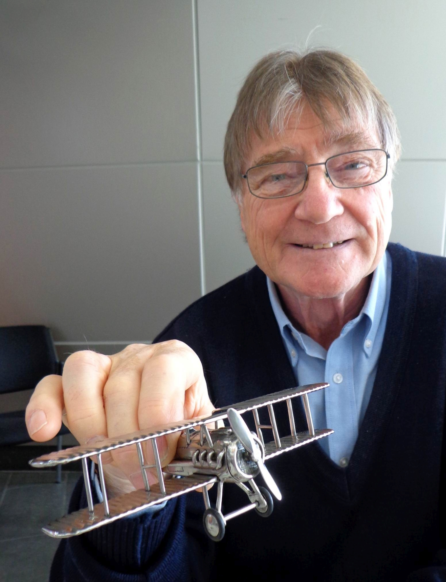 Leon Smith with one of his handmade model planes.