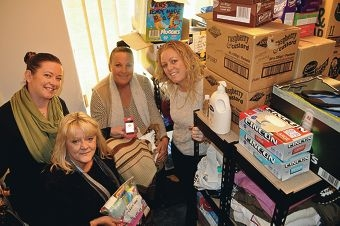 Gailan O'Connell, Debbie Player, Tanya Cairns and Fran De Gaye in their well-stocked room of gifts for the homeless.