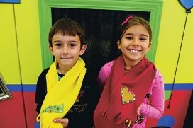Hristos (6 yrs) and Hannah Ballios (8 yrs)(NAMES OK) at the Winter warmers craft station with their scarf creations
