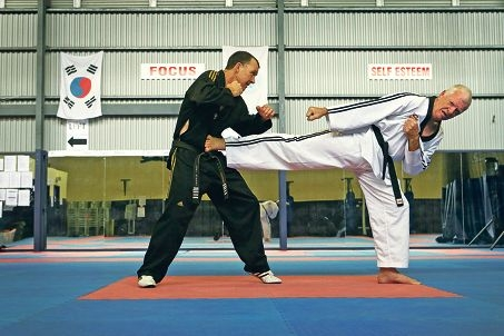 Instructor Gary Newman puts his star pupil through his paces. Picture: Andrew Ritchie www.communitypix.com.au