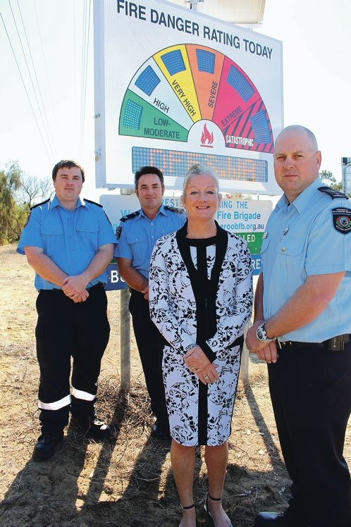 Volunteers Adam Mullaney and Renny Gosatti, Mayor Tracey Roberts and chief bushfire control officer Phil Hay.