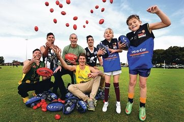 'The Recruit' host Ryan 'Fitzy' Fitzgerald (centre) with WA contestants, from left, Haden Martin, Ben Leech, Reece Maxwell and Ryan Smith and young footballers Veronica Keen (7) and Dylan Treasure (8). Picture: Marcus Whisson www.communitypix.com.au d422693