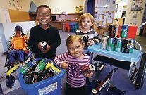 Buju Murray, Tatum Smith and Lucas Jackson with some of the cans. Picture: Elle Borgward d421629