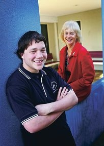 Brody (15) with Communicare Academy principal Gigi Thiele. Picture: David Baylis d422608