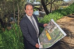 Mayor Charlie Zannino with the plans for the proposed Ellen Brook bridge.