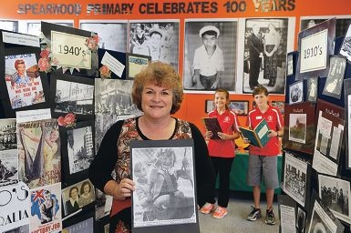 Teacher Lisa Miller with a photo of herself at Spearwood PS with head girl Jodie Ellin and head boy Kyle Gammidge.