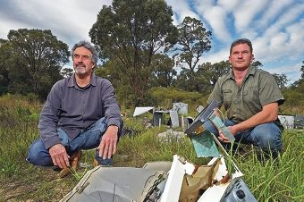 Mark Jakins and Adam Spencer are dismayed that the rubbish, including |asbestos, is dumped illegally. Picture: Jon Hewson www.communitypix.com.au d422146