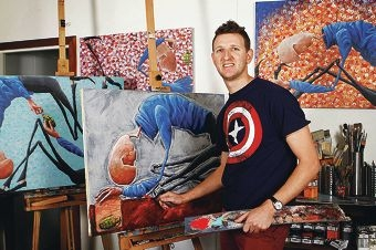 Mt Hawthorn artist Ben Brennan with some of his works.