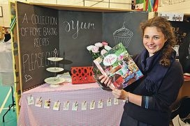 Year 10 student Ashley Crute and her newly printed cookbook. Pictures: Bruce Hunt www.communitypix.com.au d421934
