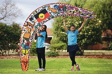Weld Square Primary School Year 6 students, from left, Sharlene Baloch (11) and Lily Dodd-Blight (11) with an artwork they helped create. Picture: Marcus Whisson www.communitypix.com.au d422102