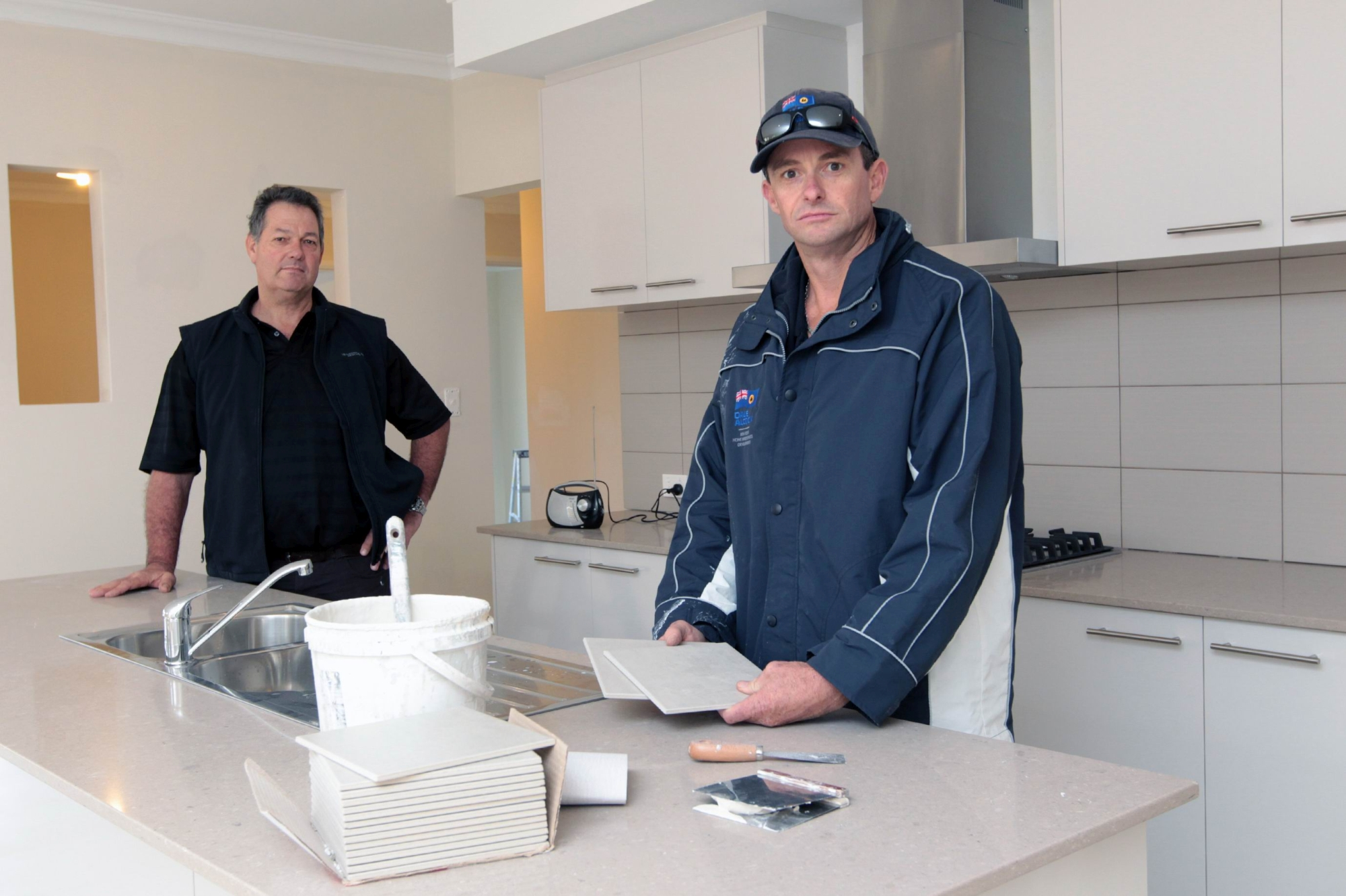 Meridian Services director Kevin Minchinton and Dale Alcock Homes' Mathew Haytton. Picture: Marcelo Palacios d422382