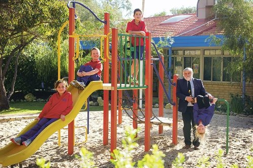 Quinns Rocks PS Year 3 students Bella Holl, Kane Pierera, Max Bennet and Mykala Hill with principal John Nowicki on the playground in line for the upgrade. Picture: Emma Reeves d422276