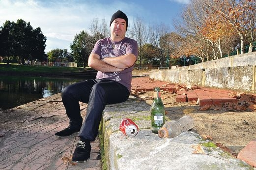 Andrija Kvaich is concerned about litter and broken paving around a Ridgewood pond.