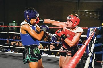 Cameron Faint (right) lands a hit on Kaine Brannan at the World Kickboxing Association Fight Night. Picture: Perth Professional Photographers.