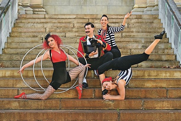 Gypsy Circus performers, from left, Ruth Battle, Magnus Danger Magnus with Merlin the schnoodle, Renee Pilkington and Erin Burley. Picture: Marcus Whisson www.communitypix.com.au d421928