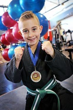 Mason Edgeloe (7) of Cloverdale. 7 year old Cloverdale resident Mason Edgeloe wins State Campionship.