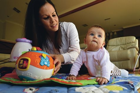 Sarah Whitehead with her second daughter, seven-month-old Paige. Picture: Marcus Whisson www.communitypix.com.au d421845