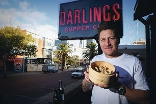 Andy Freeman with dumplings and sake at the new Darlings Supper Club. Picture: Andrew Ritchie d421674