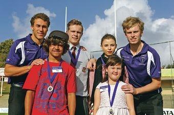 Fremantle Dockers players Jacob Ballard and Michael Wood with Alex Indich (14-Willagee),Hugo Pike (16-Mt Pleasant),Kaisha Hunt (17-Palmyra) and Emma MacBeth (7-Leeming)