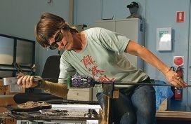 Laurie Fossier-Mills working on blown glasswork.Michelle Gauntlett's jewellery.