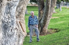North Beach resident Jack Lee with trees that are destined to be chopped down. Picture: Marcus Whisson