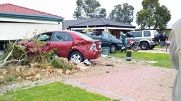 The green Holden Commodore crashed into and rolled over the red car pictured here.
