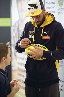 Top left: Harlow, Brendon and Smith Mak enjoy the day; The outside of the new Wyatt Grove Shopping Centre; West Coast Eagles player Chris Masten with a young fan.