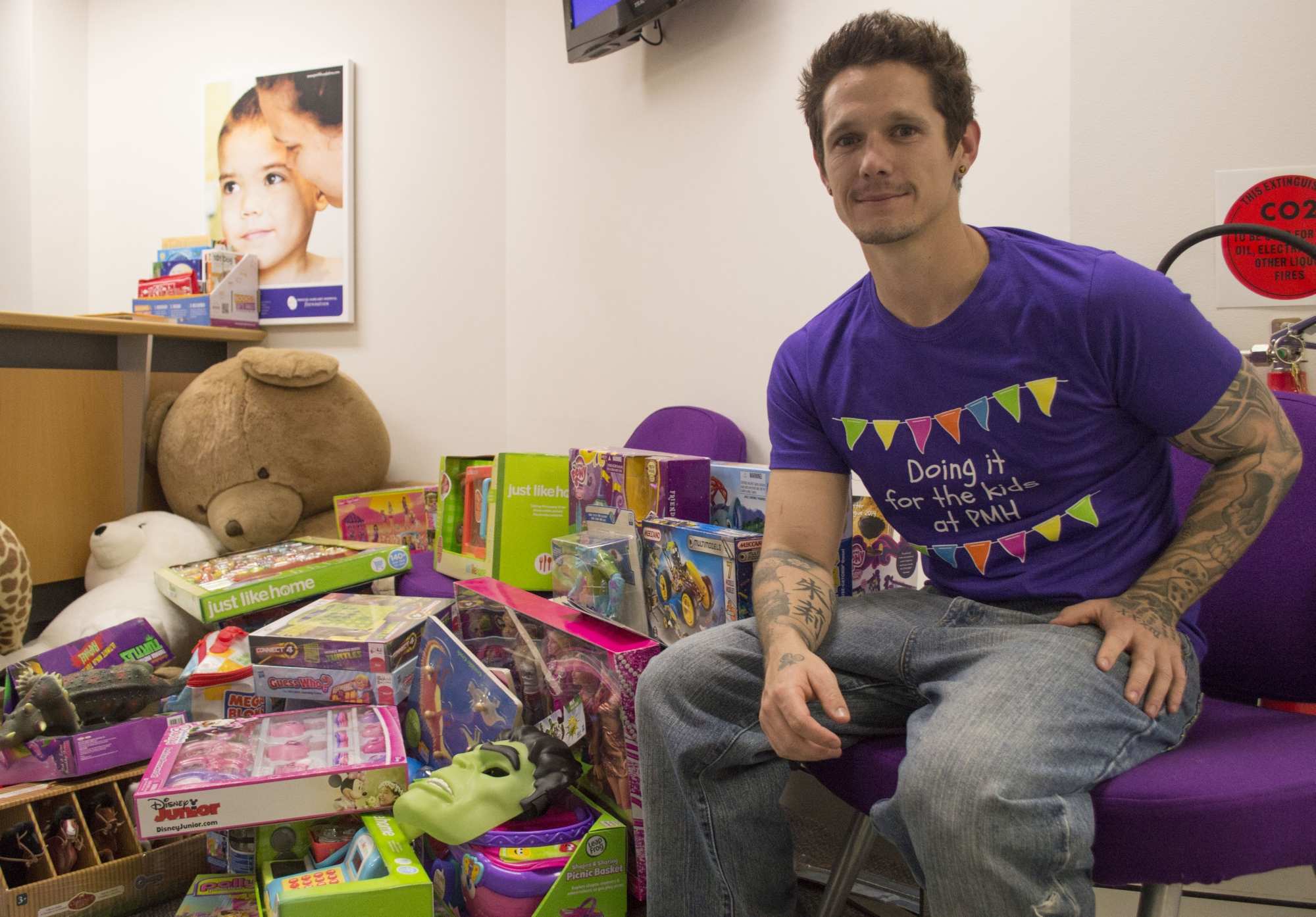 Toby Winn delivers $2500 worth of toys to PMH. Picture: Jamie Lee Stone