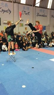Tom Roxburgh takes a high kick at a recent kickathon where more than $15,530 was raised.