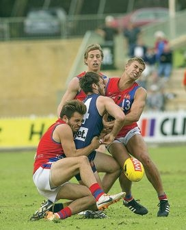Claremont's Jack Richardson is sandwiched between West Perth's Aaron Black and Luke Meadows. Picture: Dan White.