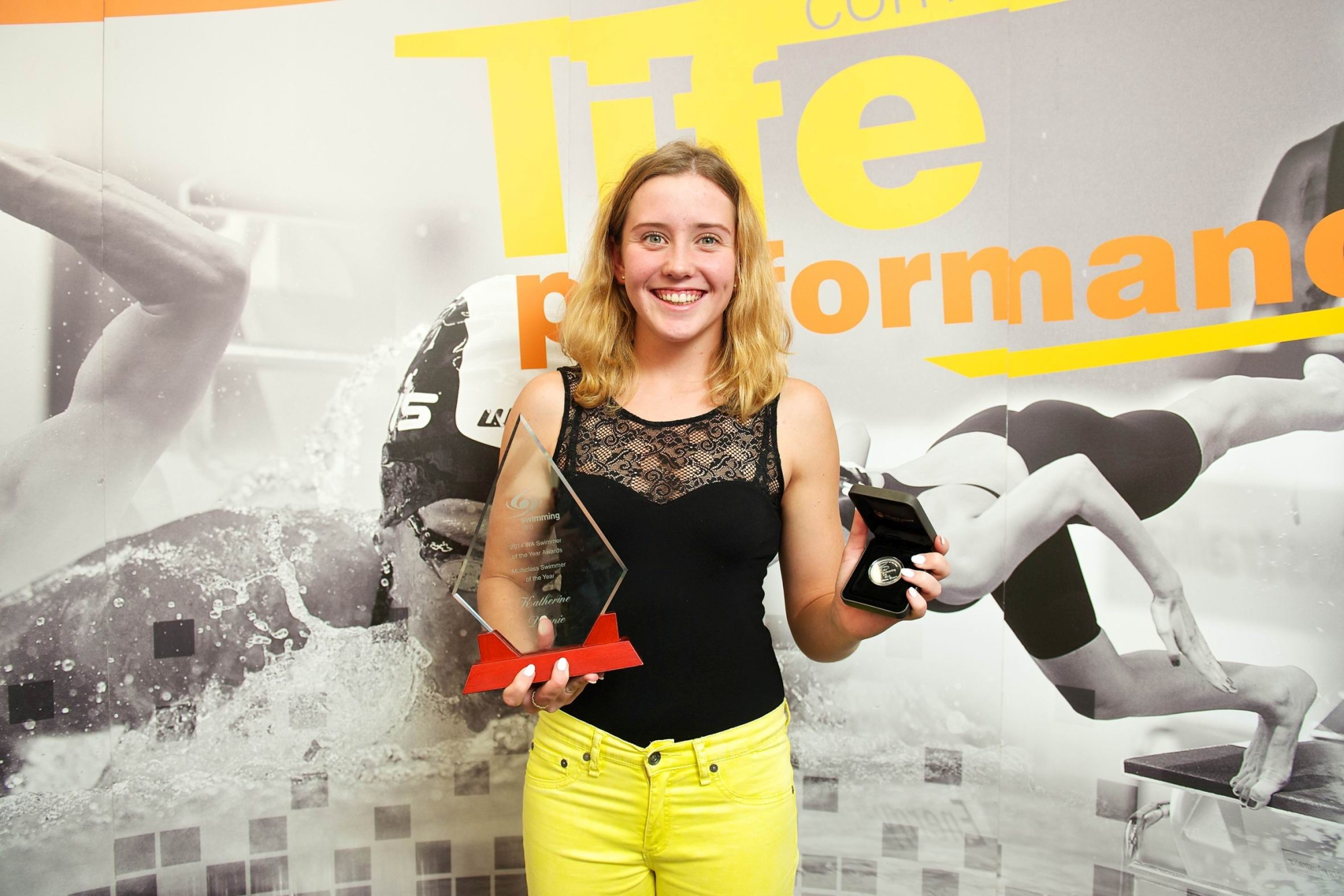 Kat Downie all smiles with her award.