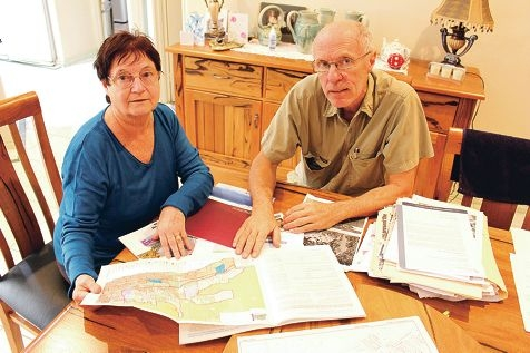 Margaret and David Manners with three decades of documents.