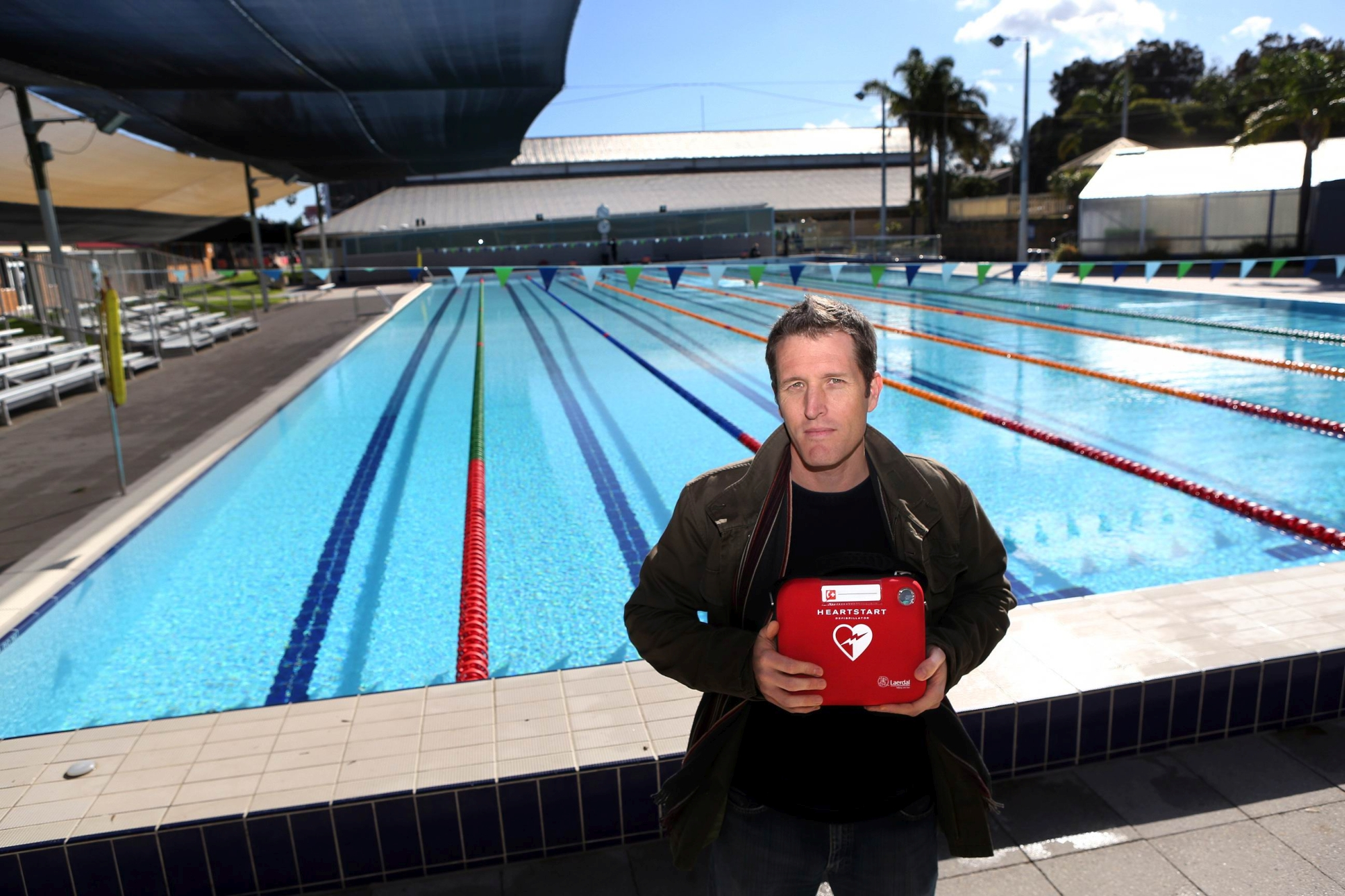 Fremantle councillor Josh Wilson with a defibrillator at Fremantle Leisure Centre.