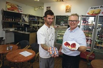 Grand Boulevard Cafe owner Douglas Hutton (right) with chef Alex Manjencic .