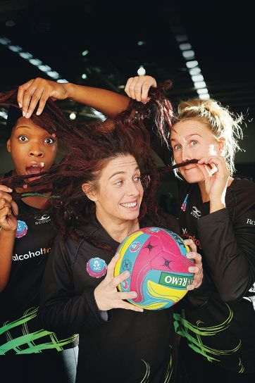 Hair-raising... Ashleigh Brazill with Fever teammates Eboni Beckford Chambers and Chelsea Pitman.