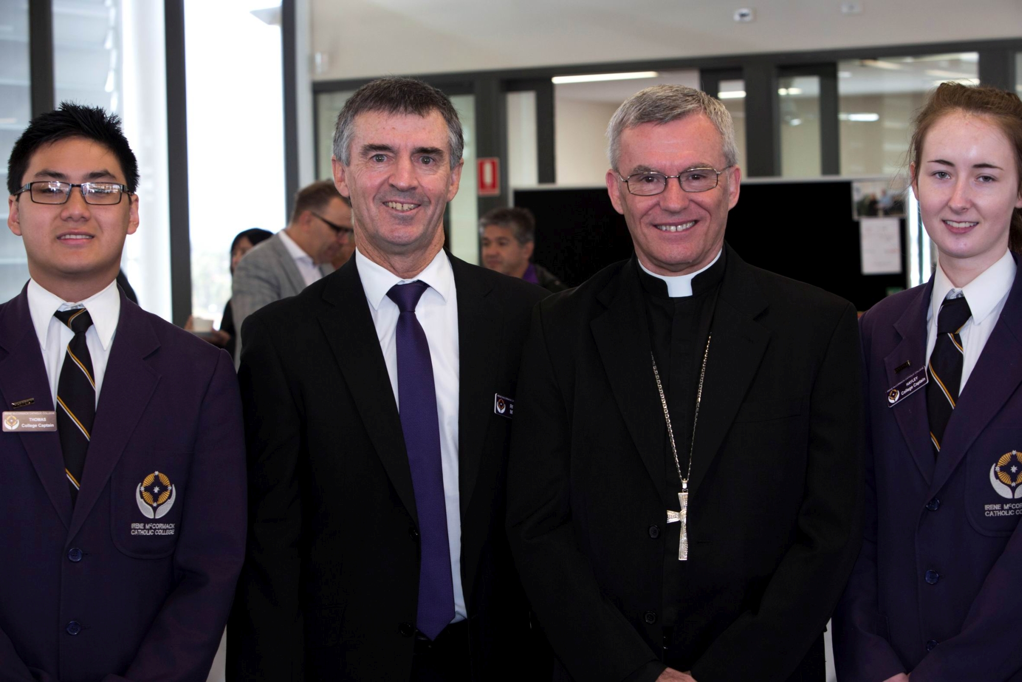 Thomas Tang (College captain), Robert Marshall (principal), Rev Timothy Costelloe SDB, Archbishop of Perth, and Hayley James (College captain).