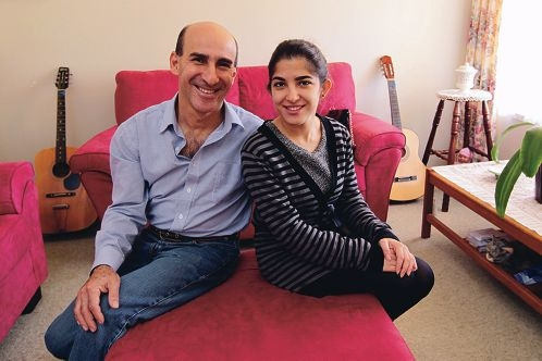 Akram Latif and daughter Shams relaxed and feeling at home in Australia. Picture: Marcelo Palacios www.communitypix.com.au d420489